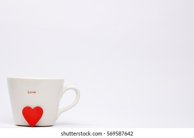 White Mug with word love on it and a heart shape