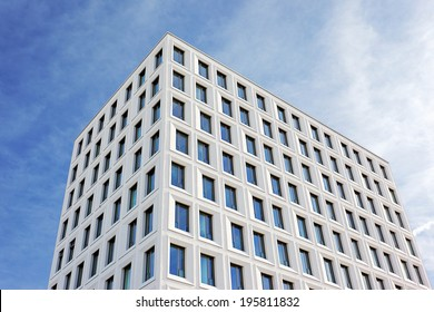white multi-story building with light blue sky