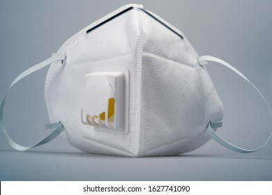 White n95 mask on blue background, n95 respirator with ventilation valve, anti-haze mask,