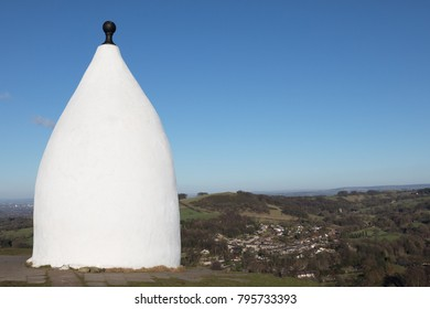 White Nancy landmark  at the end of Kerridge Hill, Bollington Cheshire overlooking Bollington.  Copy space and a blue sky.