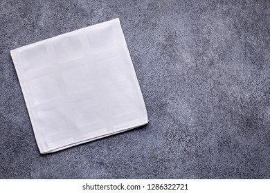 White napkin on gray concrete background top view with copy space