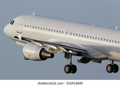 White narrow body airplane climbing into the sky