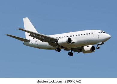 White narrow body Boeing approaching runway