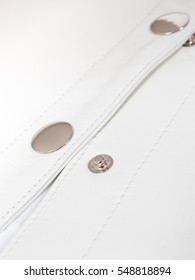 White natural soft leather with metal snap buttons opened