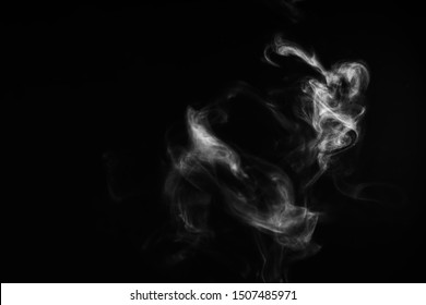 White natural steam smoke effect on solid black background with abstract blur motion wave swirl use for overlay in pollution, vapor cigarette, gas, dry ice, warm hot food, boil water smoke concepts