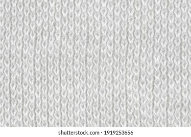 White natural texture of knitted wool textile material background. White crochet cotton fabric woven canvas texture. close up
