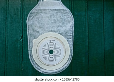 white new colostomy bag  on the green wall background