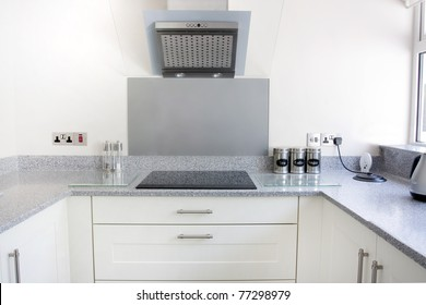 white new modern kitchen with hob and extractor fan