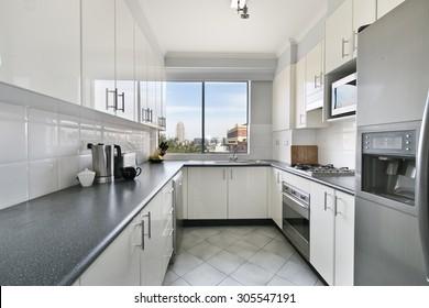 White new small simple classic kitchen interior.