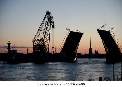 White nights in Saint Petersburg. Сrane boat passes through the Palace bridge.