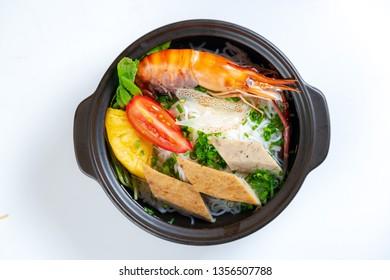 White noodles soup in a pot