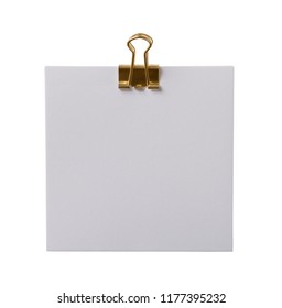 White note with a golden paperclip isolated