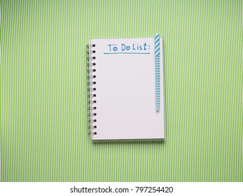 White notebook on green. To do list to be written