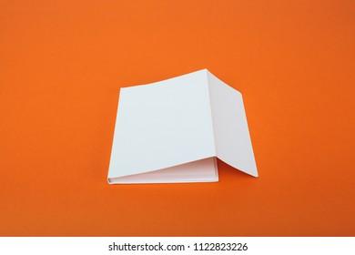 White notebook on orange background