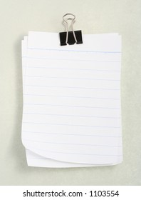 White notebook paper against gray background
