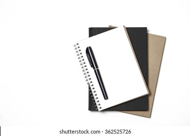 White notebook paper brown and black with black pen on white background