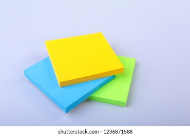 White notepad with colorful sticky reminder notes