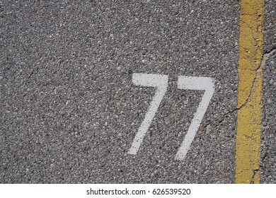 White numbers painted on concrete in camp ground at state park