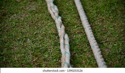 White nylon boundary ropes of a cricket ground