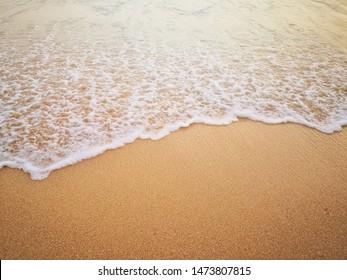 white ocean waves on sandy beach