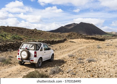 White off road vehicle in the outback of Fuerteventura Canary Islands exploring the country site.