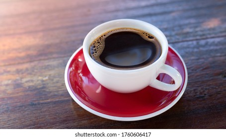 White offee cup and hot coffee americano  on wooden background