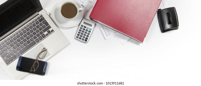 white office desk from above with laptop, folder and coffee, business concept in panoramic banner format, mock up with copy space