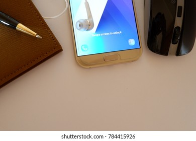 white office desk background with smartphone, diary, pen and mouse. workspace with copy space for your text.