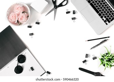 White office desk frame with laptop keyboard and supplies. Laptop, notebook, pen, roses, plant, sunglasses, clips, scissors, watch and office supplies on white background. Flat lay, top view, mockup