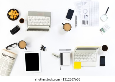 White office desk table with blank notebook, tablet pc and other office supplies. Top view with copy space, flat lay.