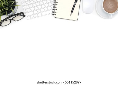 White office desk table with computer, supplies, eye glasses and coffee cup, Top view with copy space