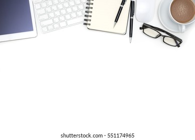 White office desk table with computer tablet, notebook, supplies, eye glasses and coffee cup, Top view with copy space