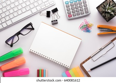 White office desk table with school accessories with office supplies. Top view with copy space