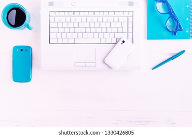 White office desk table top view flat lay - Modern desktop well organized with laptop , mobile phone coffee cup and work supplies -  Concept of creative workspace with technology devices - Image