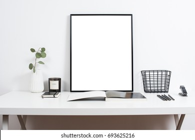 white office interior, stylish work table space with poster artw