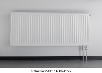 white office radiator on wall background