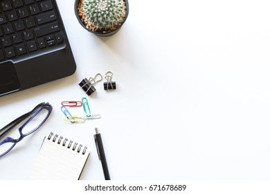 white office table with office supplies, top view - clipping path inside