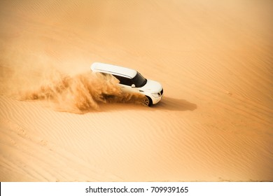 White Off-road Vehicle Dune Bashing in Middle East