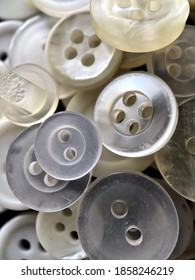 White, off-white and cream antique or vintage sewing buttons: Celluloid Buttons, Bakelite Buttons, Lucite Buttons, Vegetable Ivory, metal, China, glass, and mother of pearl.