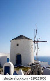 White old mill on a background of blue sky and sea  in  Oia on Santorini island,Greece