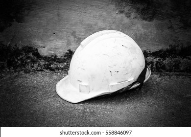 White old safety helmet on grunge background