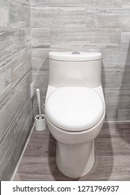 White one-piece toilet in a bathroom