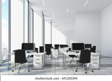 White open office with narrow tall windows, white computer tables and black office chairs. A wooden floor. 3d rendering mock up