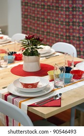 White, orange, red, yellow, turquoise and blue decorated dining table in restaurant