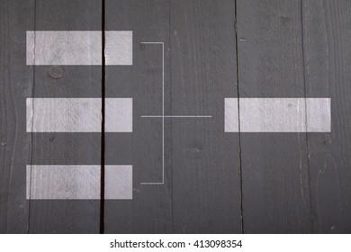 White organigram on dark wooden background