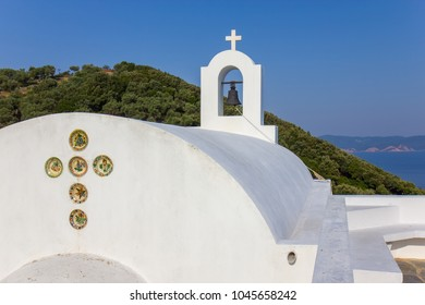 White orthodox church Agios Alexandros on the Skiathos island, Greece
