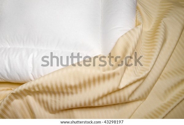 white orthopedic pillow with  beige  sheets