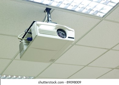 a white overhead projector on ceiling indoors