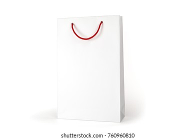 White package with a red handle, isolated on white background