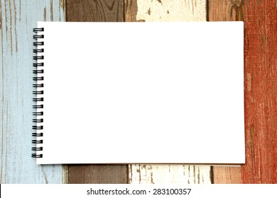 White page of sketchbook on wood pattern